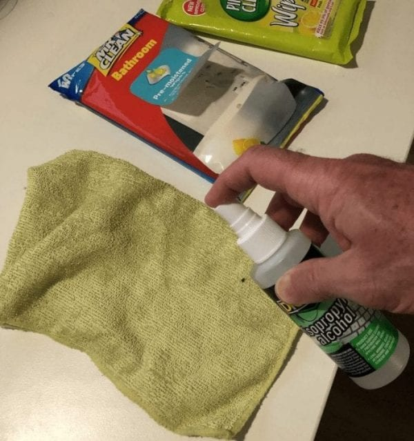 spray alcohol or cloth to clean computer